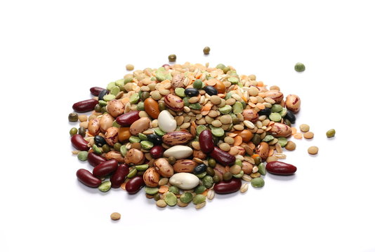 Mixed dried legumes and cereals isolated on white background