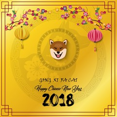 Happy chinese new year 2018 card with dog in frame and hanging chinese lantern on cherry branches