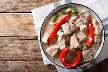 Philippine food: bicol express from a pork belly and coconut milk close-up. horizontal top view