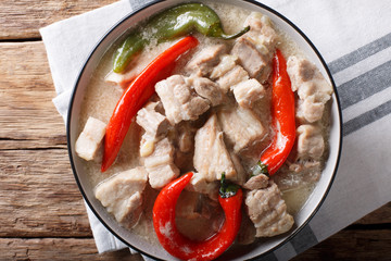Filipino cuisine: stewed spicy pork in coconut milk with chili pepper. horizontal top view