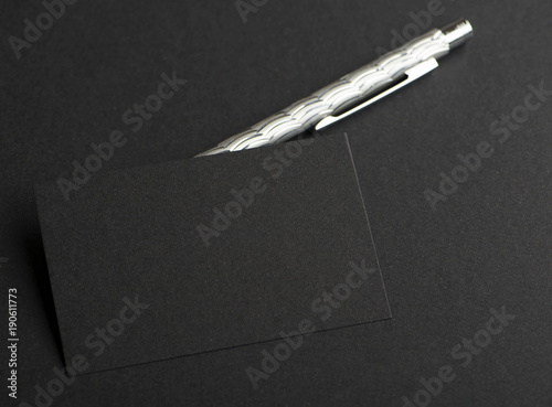 Black Business Card Next To Gray Pen On Background Mockup