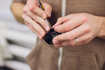a man hands repair left door Car locks repair man
