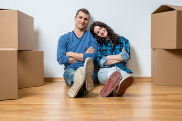 Two young couple during moving in
