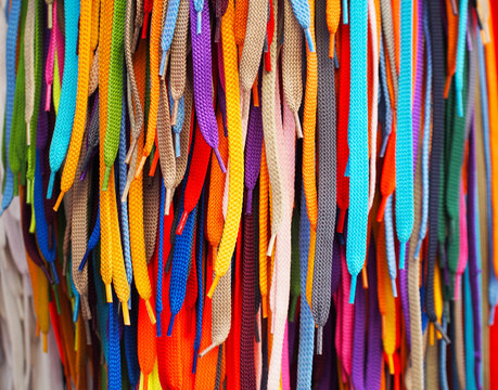 Colored bright shoelaces hang in the store