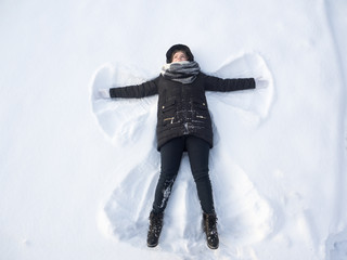 Girl in the snow angel shows . Winter angel