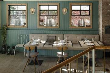 Dinning room and tables decoration front view in a cozy vintage swedish style restaurant