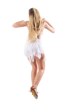 Rear view of sensual carefree energetic long hair woman dancing. Full body length portrait isolated on white studio background.