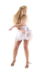Passionate female skillful dancer moving with flowing hair tousled over her face. Full body length...