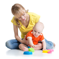 baby and mother playing together with colorful toys