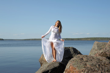 woman in a white dress at lake