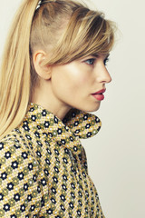 Beautiful young blond woman in profile, studio