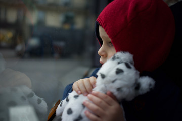 Child on Bus Travelling with Soft Toy