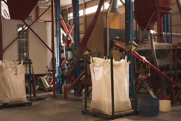Sack of grain being weighed on weight machine