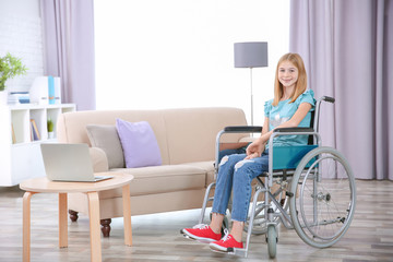 Teenage girl in wheelchair indoors
