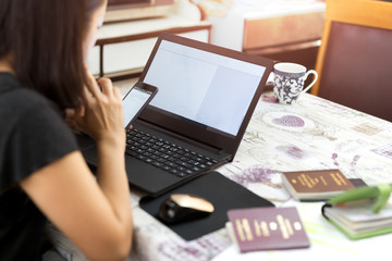 Business woman doing Passport application form fIlling on computer