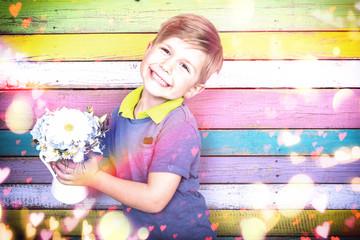 kleiner Junge mit Blumen