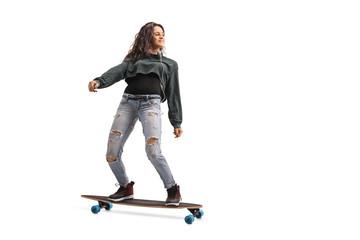 Teenage girl riding a longboard