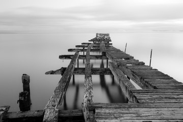 Black and white long exposure of the old dock of the Costanera in Punta arenas, Chile.