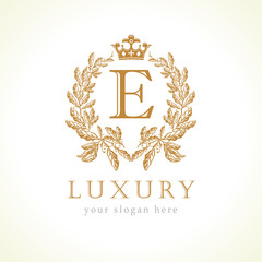 Luxury E letter and crown monogram logo. Laurel elegant beautiful round identity with crown and wreath. Vector letter emblem E for Antique, Restaurant, Cafe, Boutique, Hotel, Heraldic, Jewelry