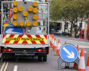 London street roadworks scene with Highway Maintenance car and Keep Right traffic sign