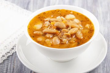 Soup of white bean   in a white plate