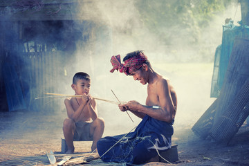 Thailand Father and son are working hand made Basket bamboo or fishing gear. Local life country Thailand