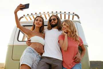 People Taking Photos With Phone During Summer Trip.
