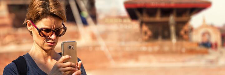 Tourist Taking a Photo with Smartphone, Bhaktapur Durbar Square, Nepal