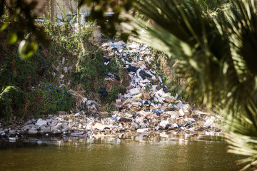 River filled with trash and plastic