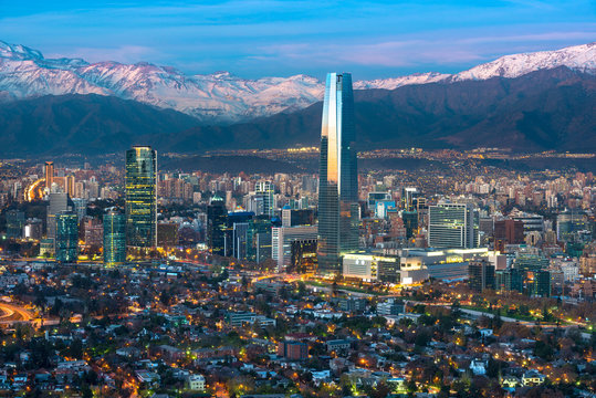 Panoramic view of Providencia and Las Condes districts with Costanera Center skyscraper, Titanium Tower and Los Andes Mountain Range, Santiago de Chile