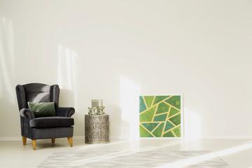 Living room with dark armchair