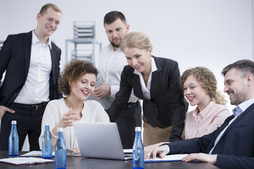 Smiling employees brainstorming