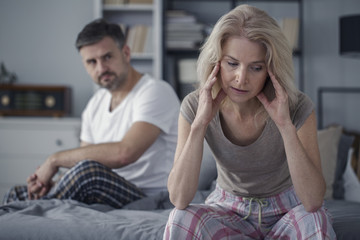 Woman with headache and husband