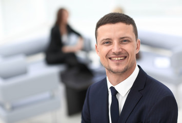 successful businessman on blurred background office