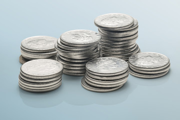 stacks of coins isolated on a reflective surface