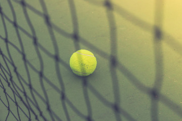 close-up tennis ball and net on court