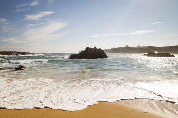 beautiful beach with waves breaking on the shore and without people