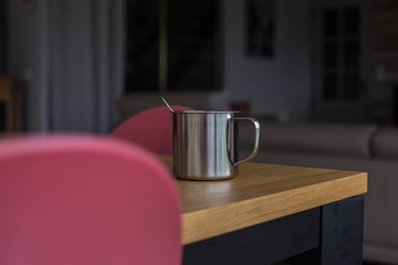 Cup between two chairs