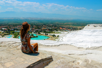 Woman take a picture of beautiful hill and village nature top view in Turkey