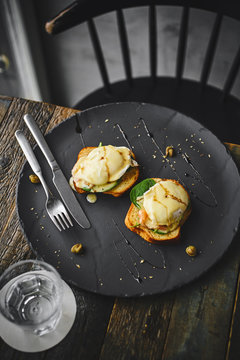 Eggs benedict on a rustic cafe table