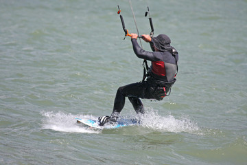kitesurfer riding his board