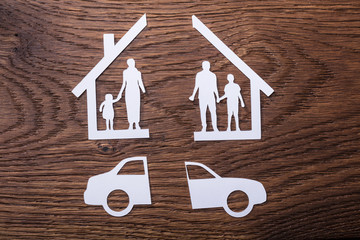 White Paper Cutout Of A Family Split Apart With Car