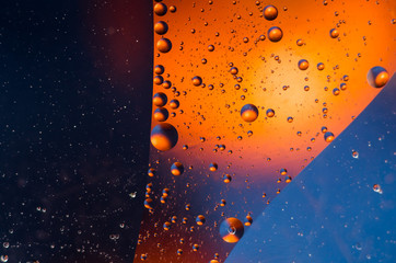 Oil drops on water surface abstract background