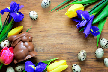Easter background with a chocolate bunny