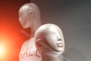 Heads of two mannequins on a black background