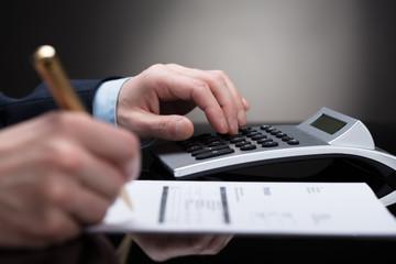 Businessperson Checking Invoice