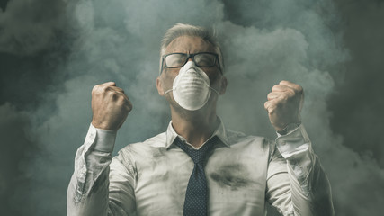Angry businessman and pollution