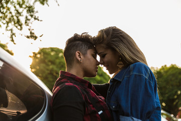 Lesbian Couple Kissing in Car - Sunset Time