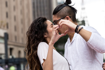 Young Asian Couple Making a Heart Shape with Their Hands