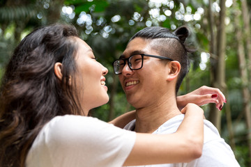 Romantic Young Asian Couple Kissing